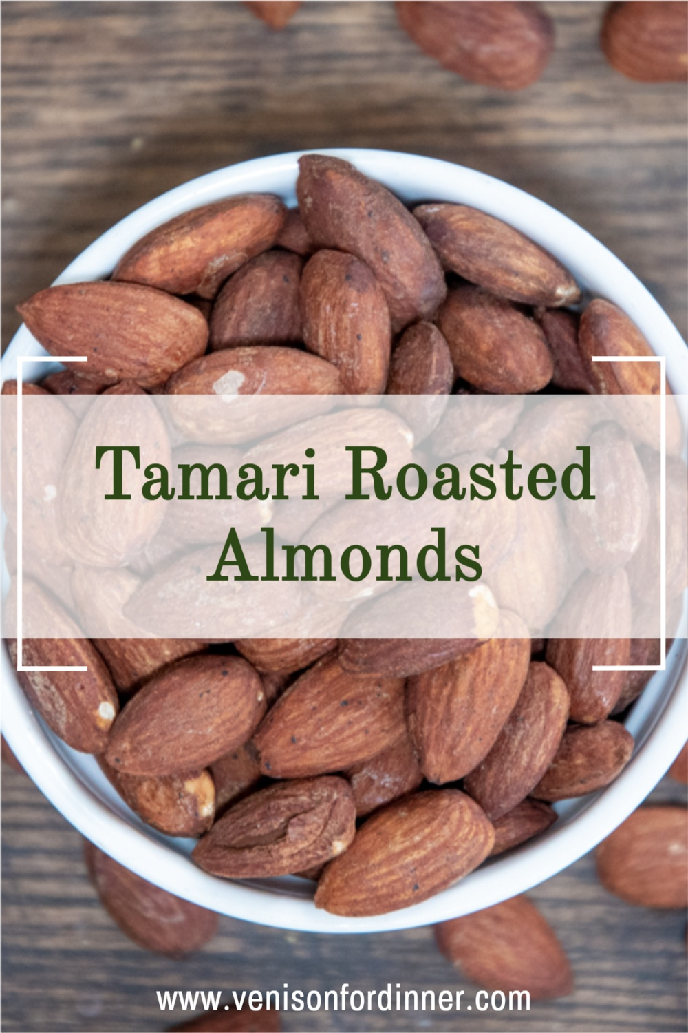 tamari roasted almonds in a white bowl from above