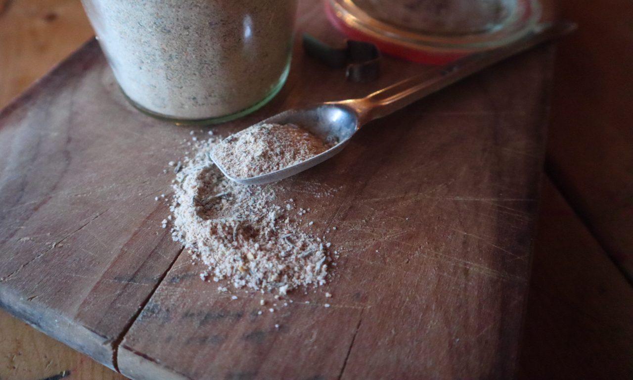 wild mushroom seasoning salt weck jar wooden cutting board canning jar metal spoon