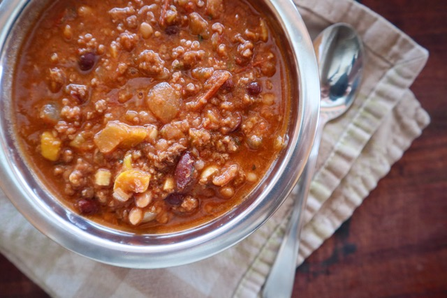 Baked bean and moose chili in a silver bowl.