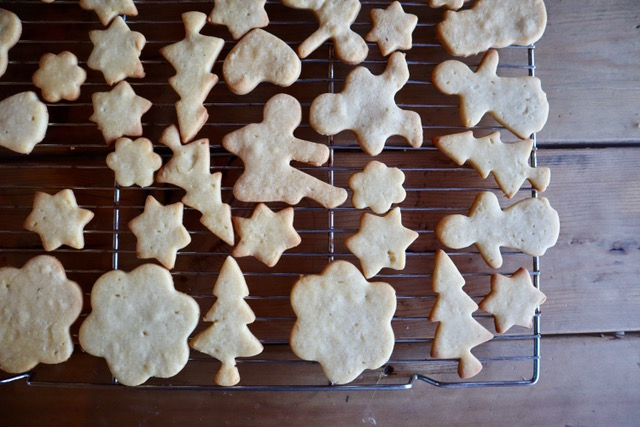 Overhead shot of cut out cookies on a cooling rack.