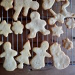 Cut out cookies on a cooling rack.