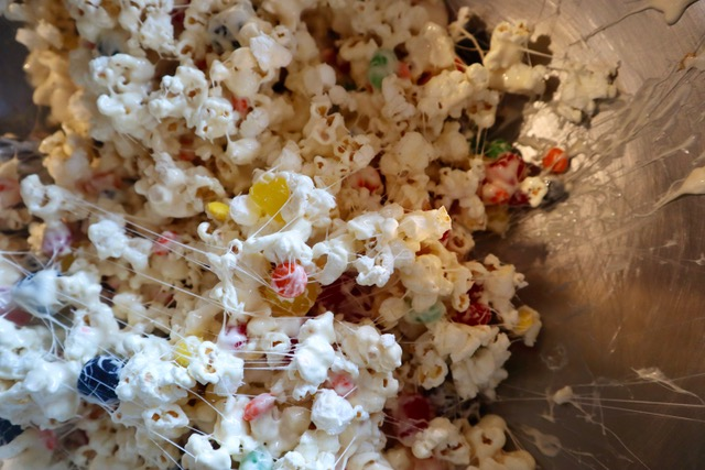Mixing up popcorn cake in a bowl.