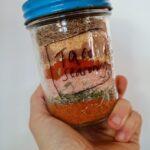 Homemade taco seasoning in a labeled mason jar.