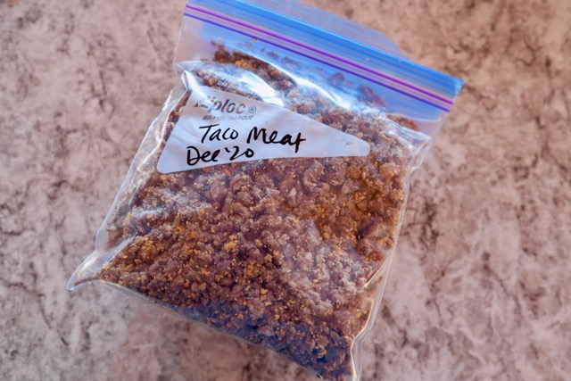 Cooked taco meat in a quart freezer bag.