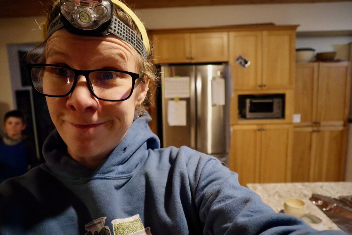 Me wearing a headlamp to grill on a winter evening.
