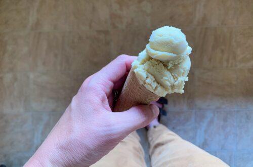 Coffee ice cream in a sugar cone.