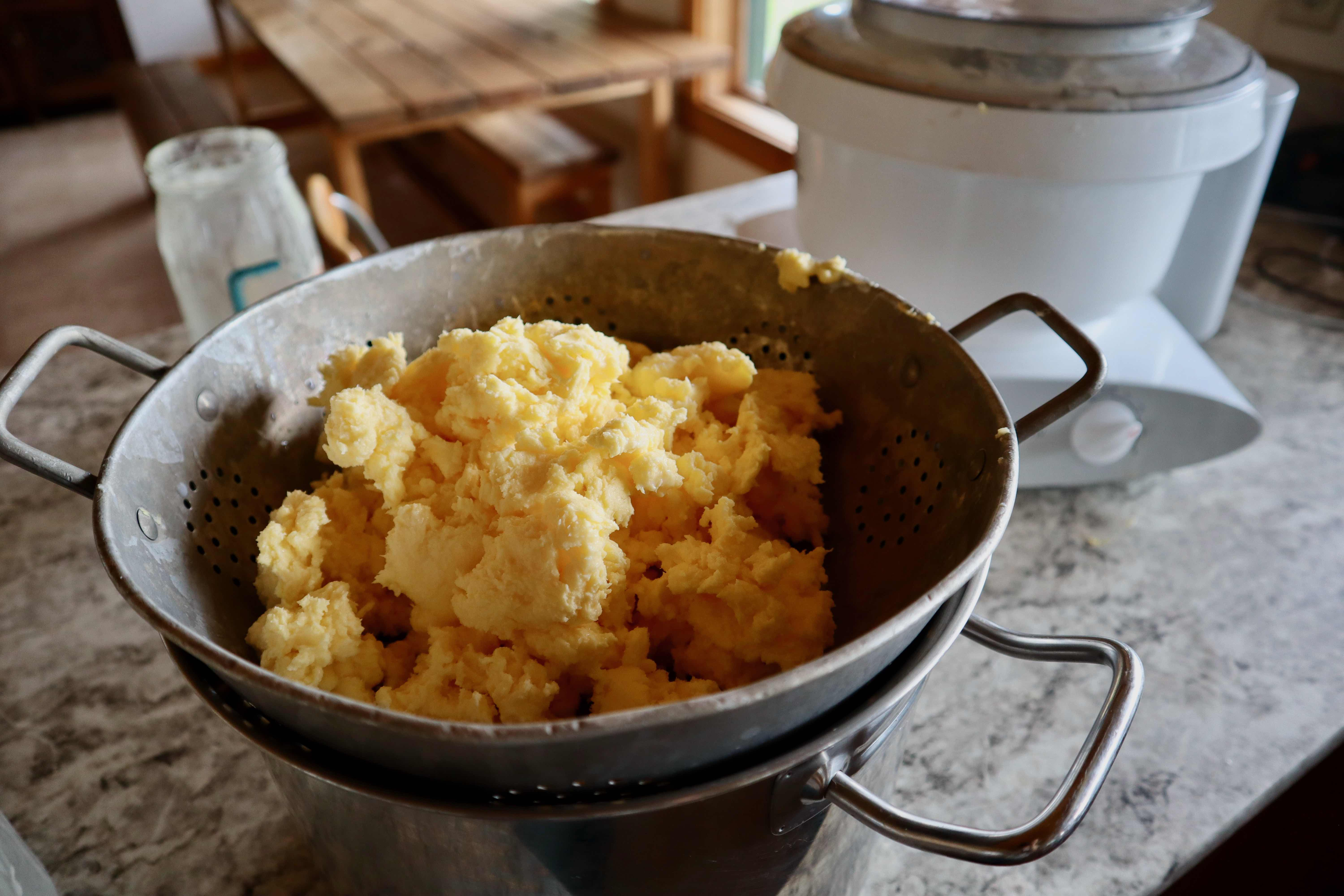 Butter in a colander after straining out the buttermilk.